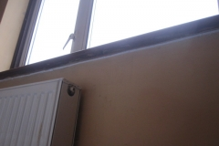 Draught through gap under window board