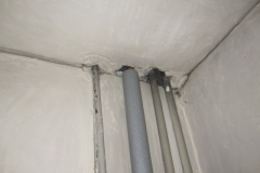 Holes round pipes into loft
