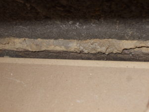 An open gap between the edge of the g/f ceiling and the blockwork, these can vary in size from a few millimeters to large enough to accommodate pipes, see last few pictures in this section
