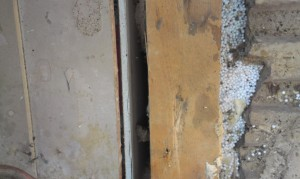 Here we can Look down on a ceiling that needs sealing. The red that can be seen through that crack is the back of the coving, not usually visible after either plastering or dry lining. Wind and cold air should not be able to access the back of any coving and we can see clear down the back of the wall lining board. Living in this house was like living in a plasterboard tent.